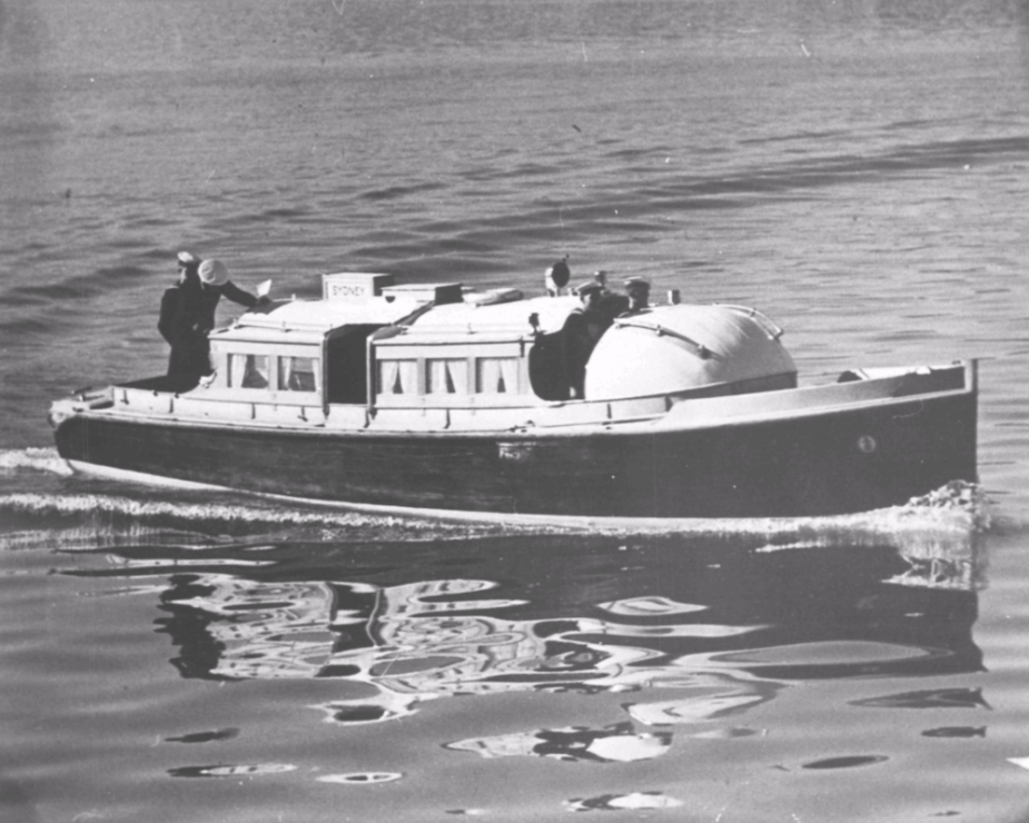 Sydney carried two 35-foot motor boats that were normally used to ferry personnel to and from the ship when at anchor or moored to a buoy. When not in use they were mounted on 'boat crutches' situated amidships, slightly forward of the ship's bakery.