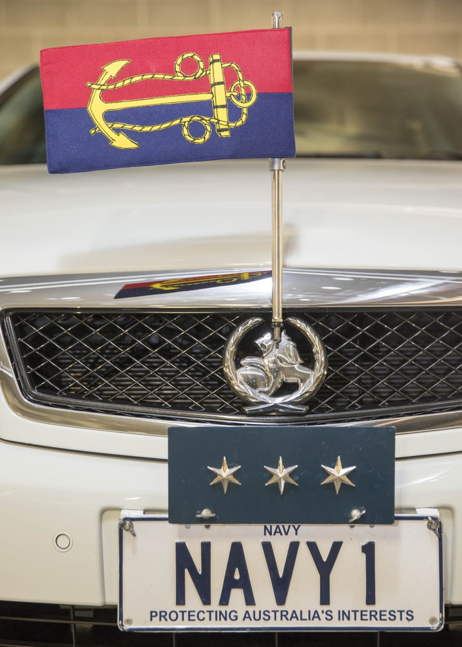 Chief of Navy's staff car displaying his personal flag, star plate and unique license plate.