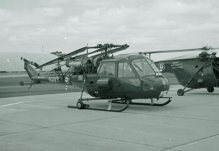 Scout 841 (891) parked on an airfield apron with engine cowlings removed and rotor blades folded back.