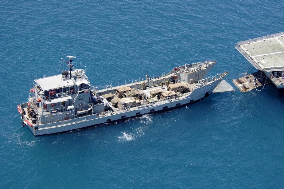 HMAS Betano approaches HMAS Kanimbla to carry out a stern door marriage near Cowley Beach, Queensland, during Exercise SEA EAGLE 05.