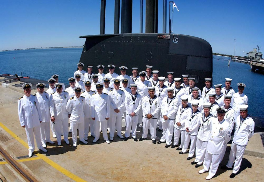 Officials and crew of HMAS Collins following her rededication into service on 1 December 2005. Note the chrome C-merang visible at the top of the 'fin'.