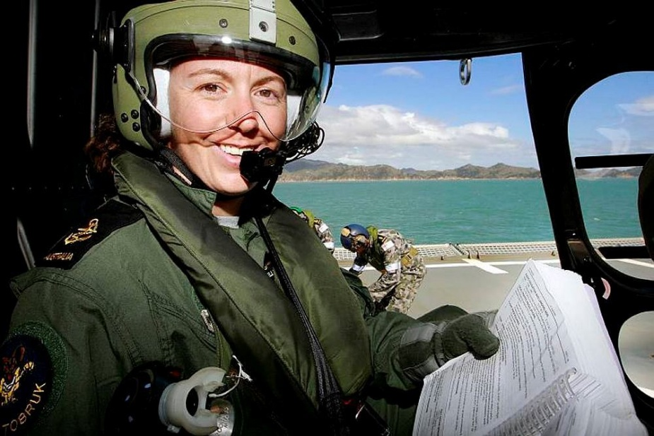 Leading Seaman Aircrewman Leanne Billington reads a flight manual before flying during Operation Samoa Assist.