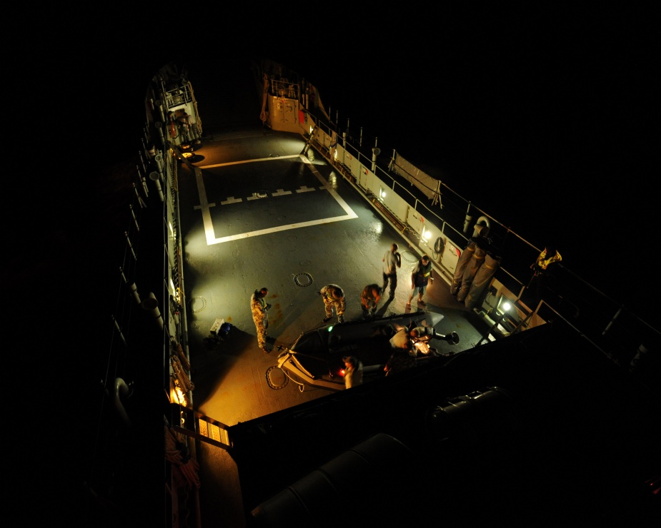 HMAS WEWAK's crew prepare the zodiac for night boat evolutions, in the Solomon Islands during Operation ANODE, 2010