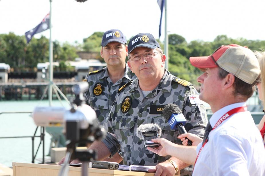 Chief of Navy, VADM Russ Crane conducts media interviews regarding SIEV 221 at HMAS Coonawarra. WO-N Mark Tandy watches on, 24 December 2010.