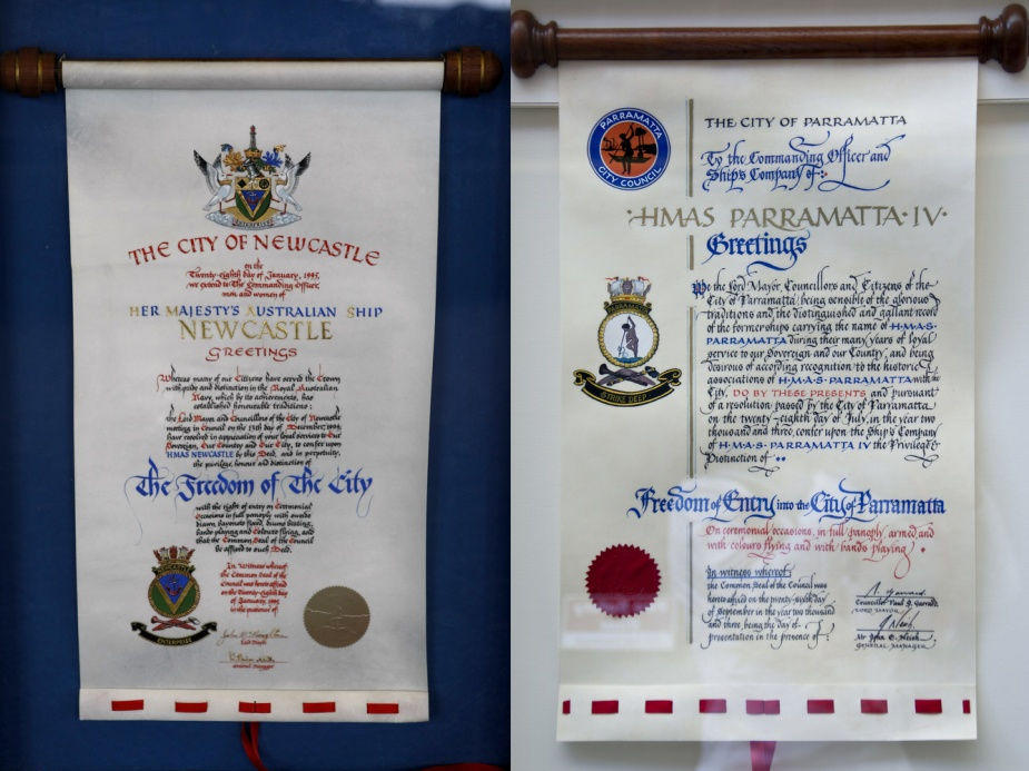 Two examples of ornate scrolls honouring HMA Ships Newcastle and Parramatta with Freedom of Entry.