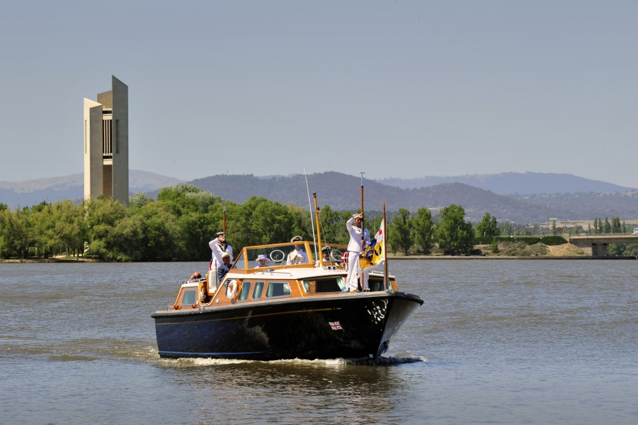 Her Majesty Queen Elizabeth II is ferried across Lake Burley Griffin in Canberra during the 2011 Royal Visit. Note the presence of her personal flag flying in the bows of the royal barge.