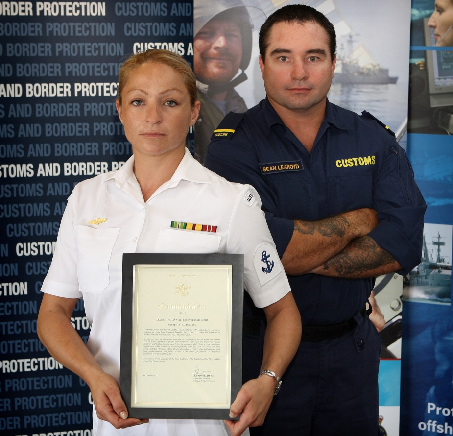 Assail Three crew member Leading Seaman Boatswains Mate Nikki Bebonis, with ACV Triton crew member Sean Learoyd after receiving commendations for their involvement with the SIEV 221 incident at Christmas Island in December 2010.
