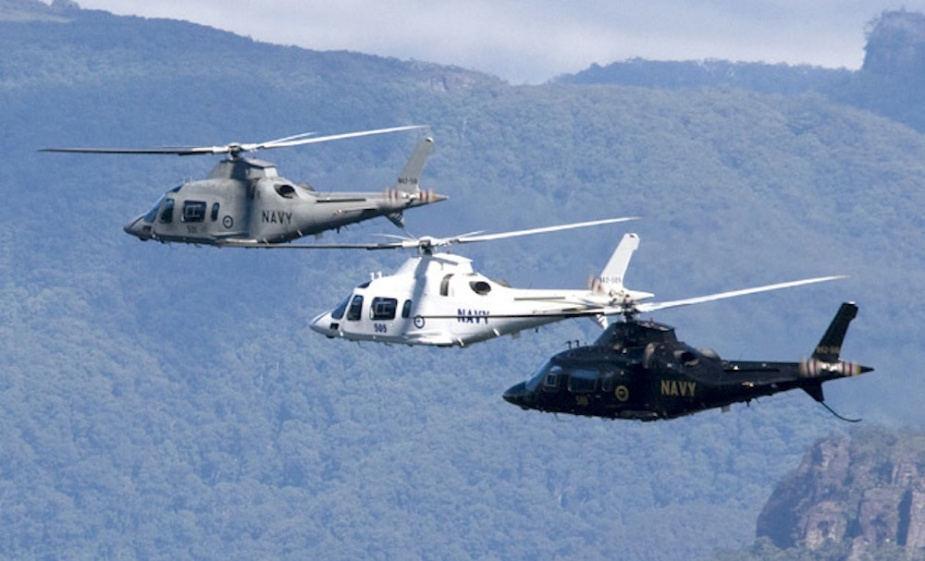 Three Australian Navy Agusta A109E helicopters conducting their final flight.