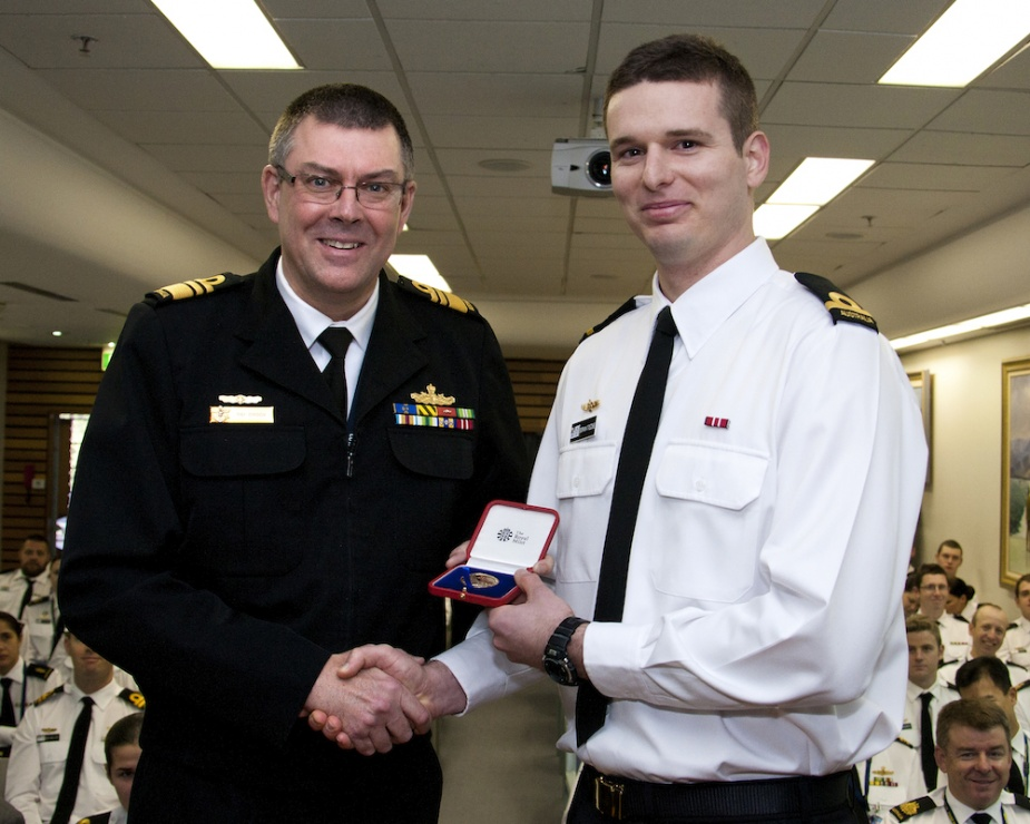 Vice Admiral Ray Griggs AO, CSC, RAN, Chief of Navy presents Sub Lieutenant Boman Trezise RAN, with Her Majesty the Queens Gold Medal for his outstanding performance during Junior Warfare Application Course Phase III.