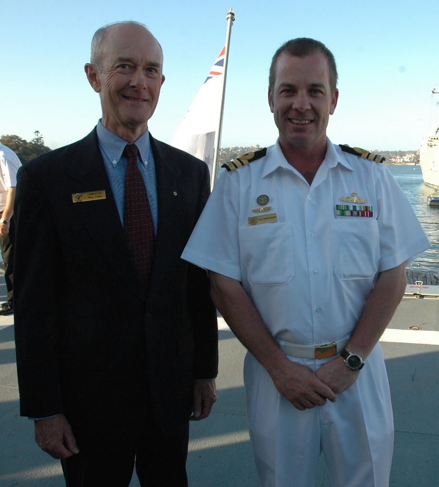 HMAS Sydney's commissioning Commanding Officer Commodore Paul Kable and her last Commanding Officer Commander Karl Brinckmann celebrate the ship's 30th anniversary.