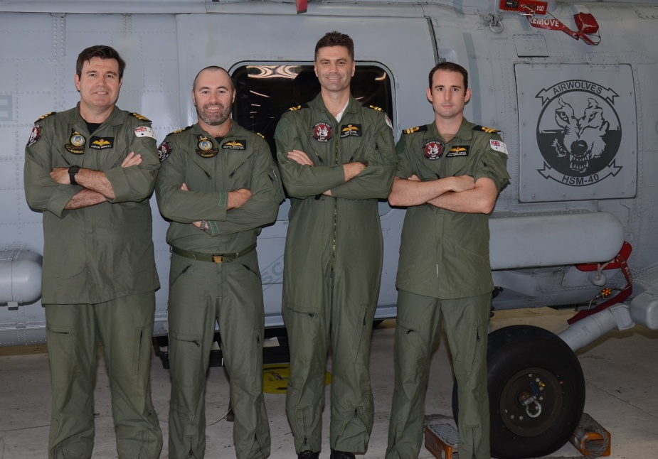 NUSQN 725 crewmembers LEUT Aaron Abbott, LCDR Michael Robertson, LEUT John Flynn and LEUT Warren Oates in Jacksonville after completing Naval Air Training and Operation Procedures Standardization checks in July 2013.