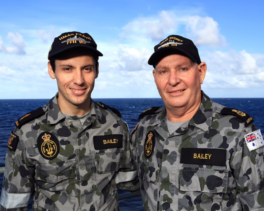 Able Seaman Andrew Bailey (left) of HMAS Perth meets with his father, Chief Petty Officer Graham Bailey of HMAS Sydney, during Exercise TALISMAN SABRE 2013.