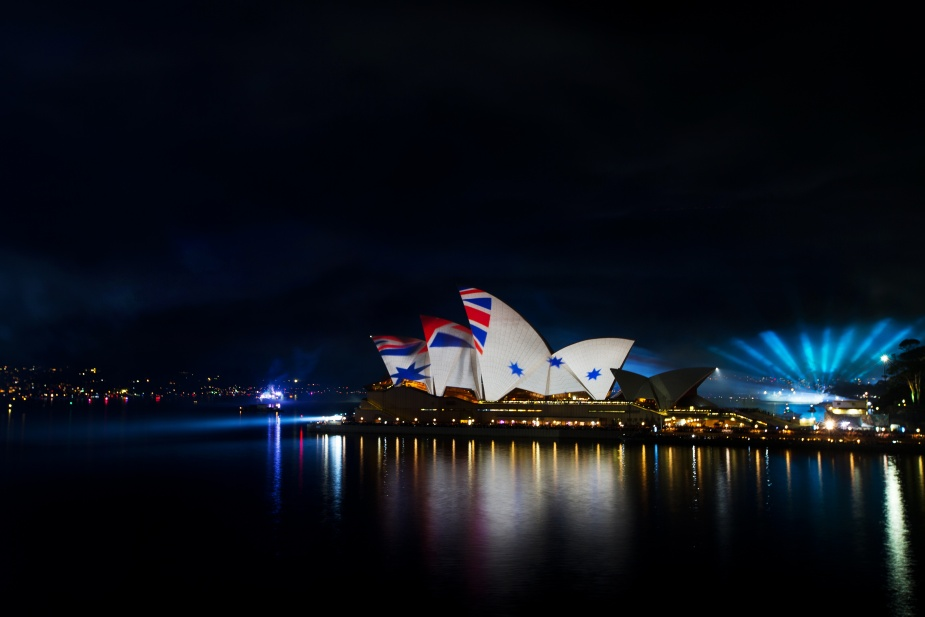 An overt affirmation of the close link between the Navy and the Nation - The Australian White Ensign projected on the sails of the Opera House in Sydney during the 2013 Fleet Review.