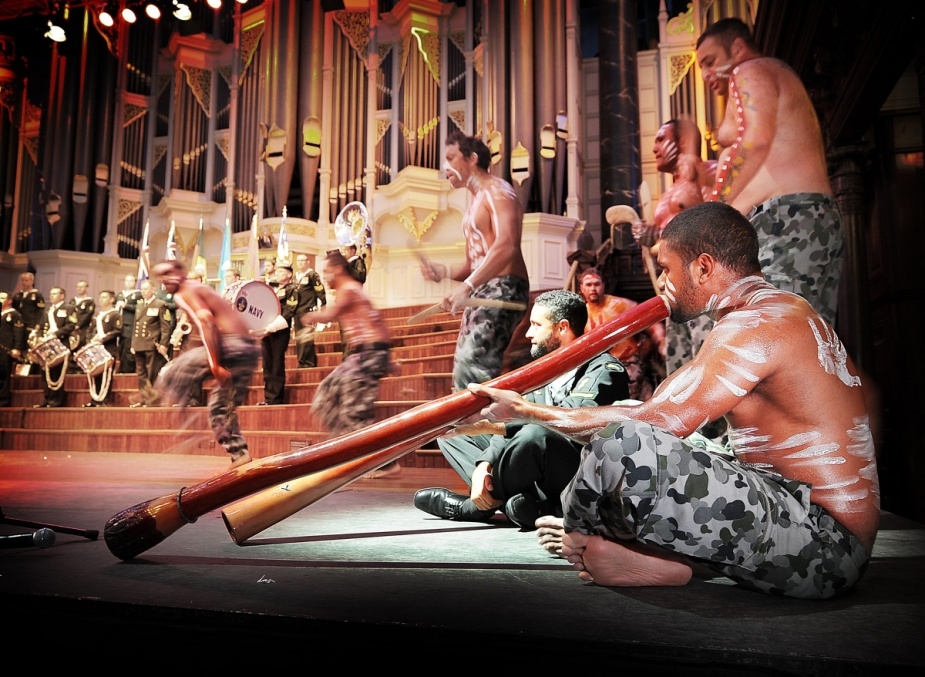 The Royal Australian Navy's Indigenous Performance Group provides a display to the 800 guests at the Town Hall reception, at the completion of the Combined Navies Parade held in October 2013 during the International Fleet Review.