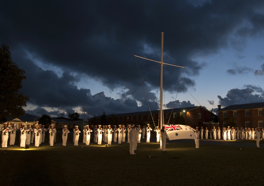 The tradition of ceremonial sunset being observed at the RAN Recruit School, HMAS Cerberus.