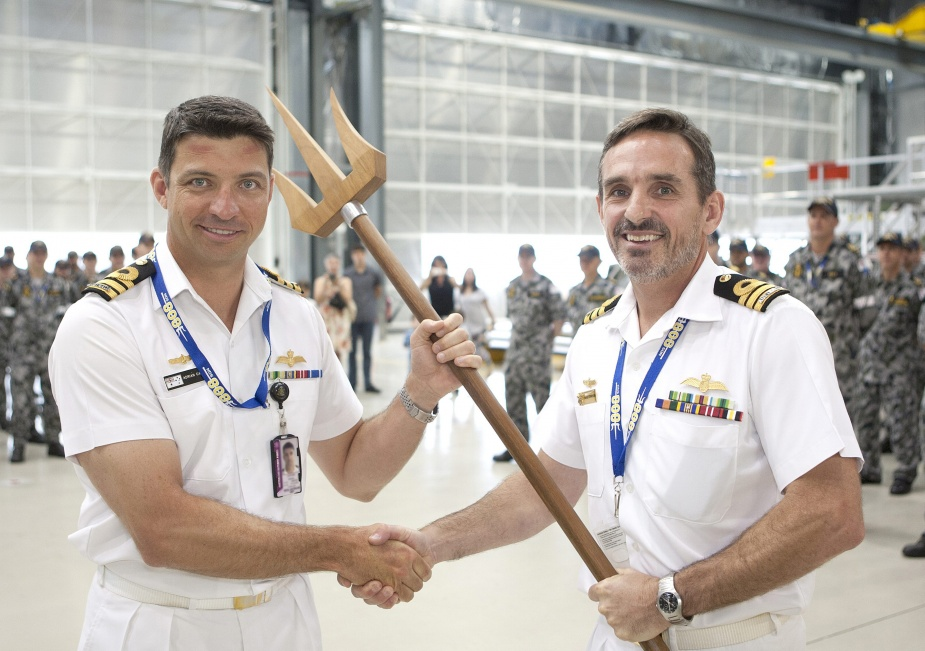 CO 808SQN CMDR Charlie Stephenson presents a ceremonial trident to CMDR Adrian Capner as a symbol of his assumption of command
