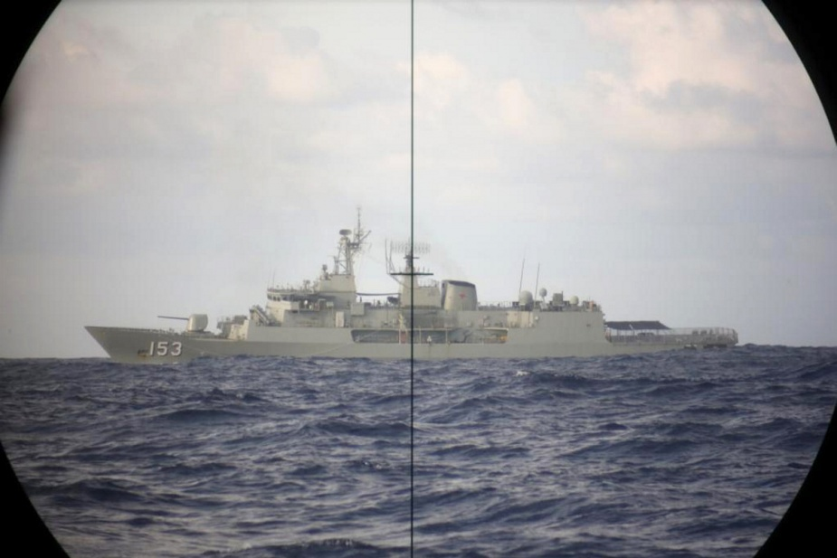 Anzac class frigate, HMAS Stuart, is observed through periscope on board the Collins class submarine, HMAS Sheean, during a routine transit and training exercise off Christmas Island.