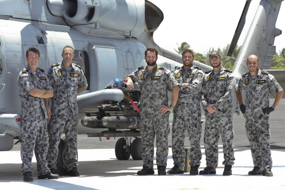 Members from NUSQN 725 fit the first 'Hellfire'missile to be fired from the MH-60R Seahawk 'Romeo', in Florida, United States of America.   (from left) Petty Officer Aircraft Technician Avionics (ATV) Ray Warren, Chief Petty Officer ATV Phil Copley, Able Seaman (AB) ATV Josh Beaven, ABATV Josh Miller, Leading Seaman (LS) ATV Gian Archer, LSATV Mark Goodwin.