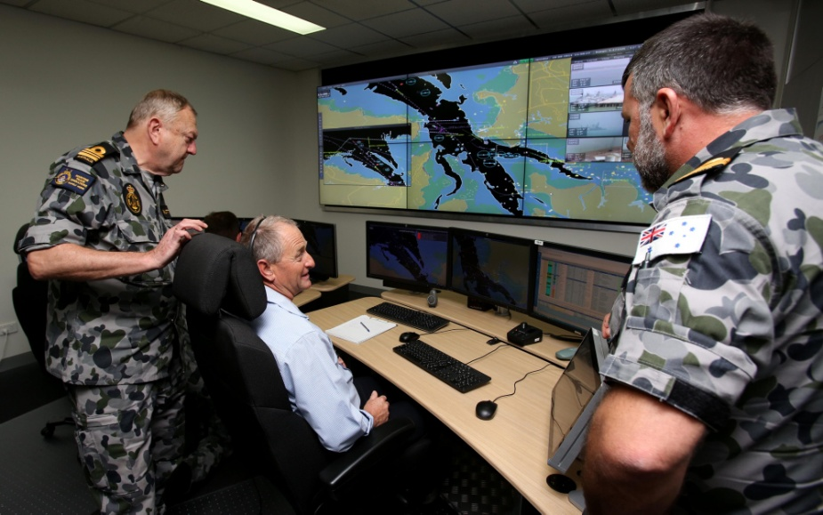 Maritime Trade Operations (MTO) Officer, Lieutenant Commander Peter Button, Harbour Control Tower Officer, Mr Ian Murphy and MTO Officer, Lieutenant Rob Webber at the Darwin Port Corporation Harbour Control Centre during Exercise KAKADU 2014.
