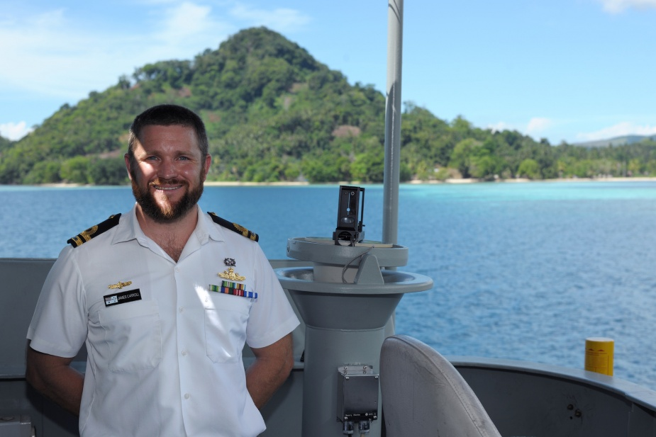 Commanding Officer HMAS Tarakan, Lieutenant James Carroll on the bridge wing of the Landing Craft Heavy off the Weather Coast, Solomon Islands, September 2014
