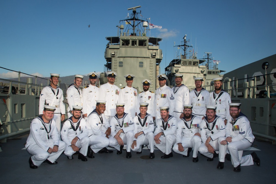 HMAS Brunei's decommissioning crew gathers on her tank deck for the final time.