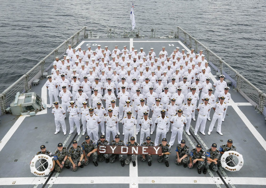 Top: HMAS Sydney enters Sydney Harbour for the last time while flying her decommissioning pennant on 27 February 2015. Bottom: Her decommissioning crew in Jervis Bay.