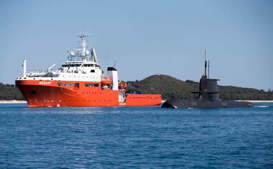 HMAS Rankin sails past MV Besant in Cockburn Sound, Western Australia during Exercise Black Carillon 2015.