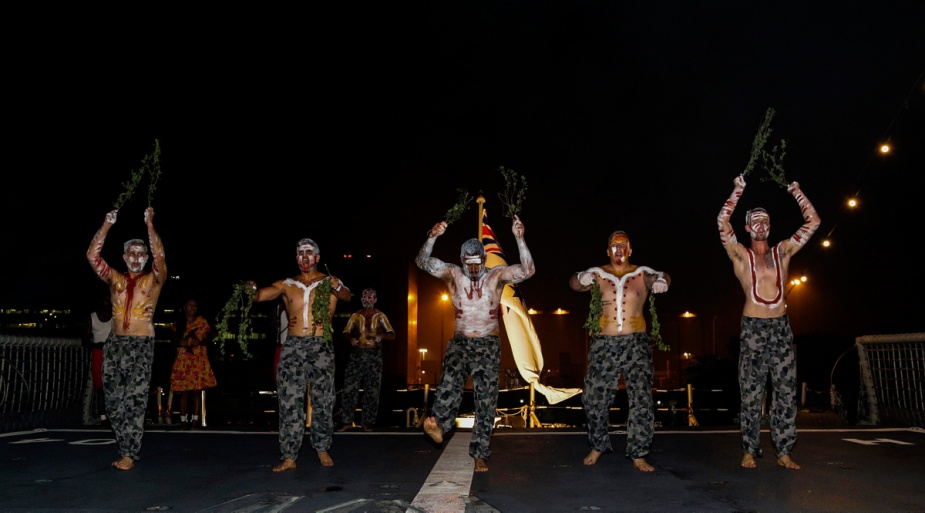 Bungaree members embarked in HMAS Darwin perform for guests on the flight deck of HMAS Darwin during an event in Jakarta, Indonesia.