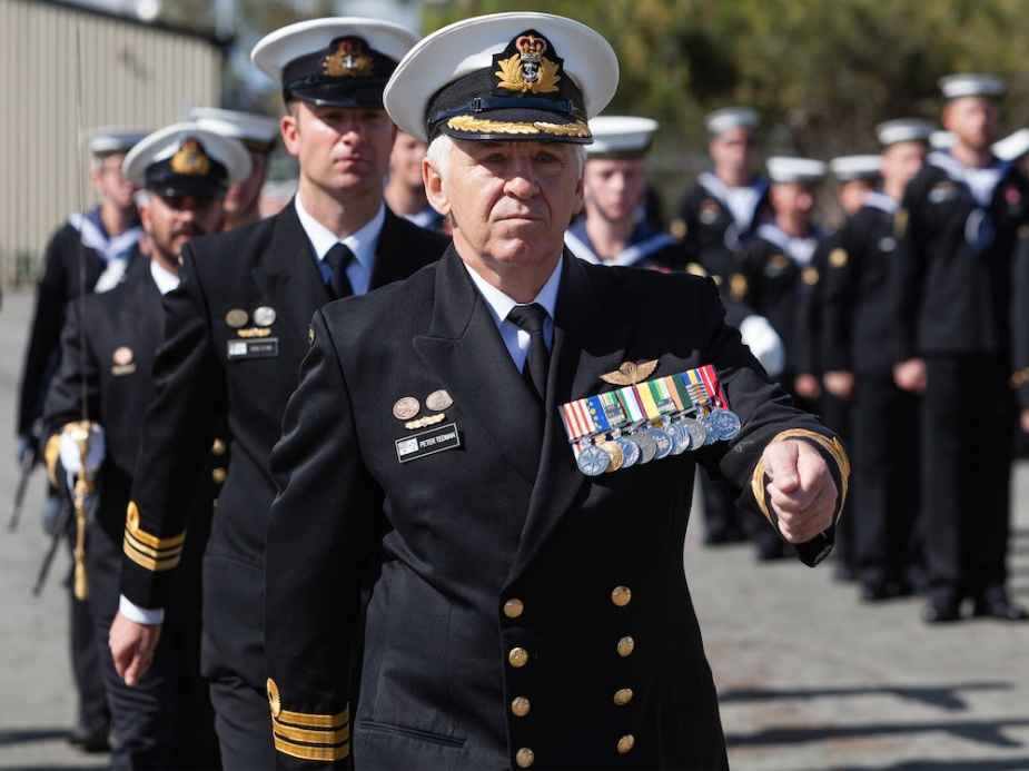Commanding Officer HMAS Moreton Commander Peter Tedman, DSM, OAM, RAN, leads HMAS Moreton's ship's company past the dias during the commissioning of HMAS Moreton.