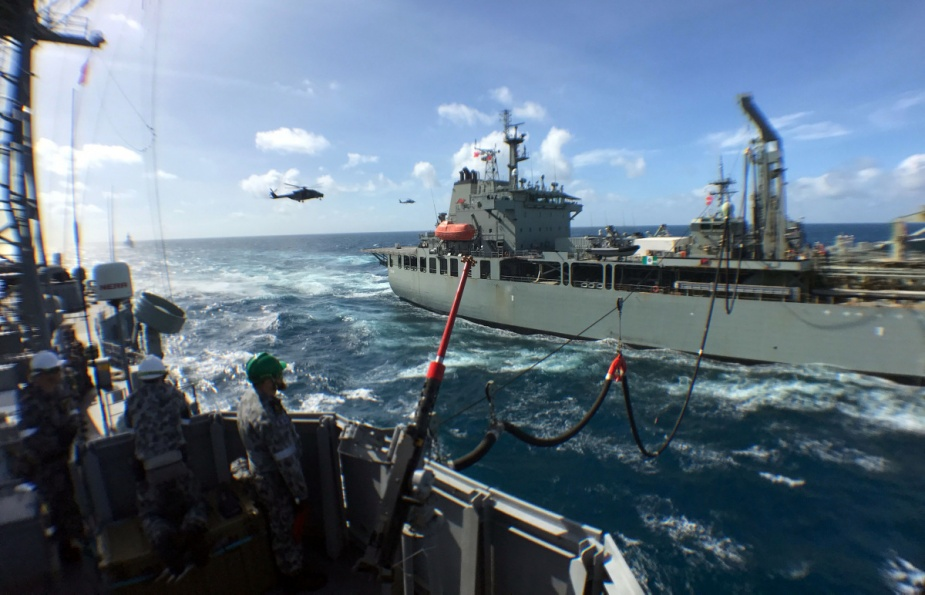 HMAS Sirius conducts a dual replenishment at sea with HMA Ships Melbourne and Darwin.