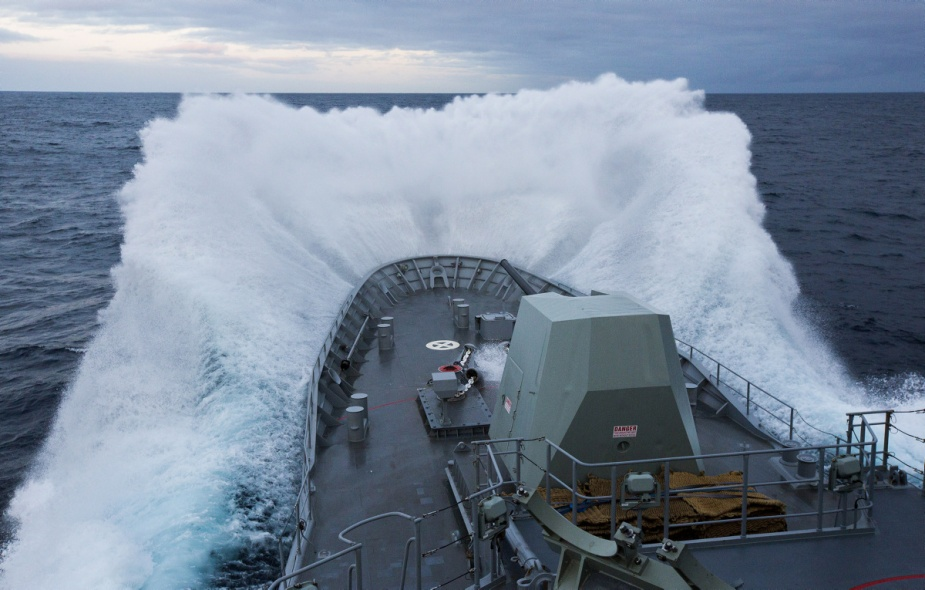 HMAS Warramunga breaks through the ocean waves whilst transiting to Fleet Base West prior to deployment to the Middle East region.