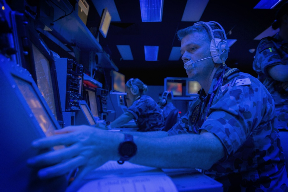 HMAS Newcastle's Lieutenant Adrian Hicks operates the Aviation Warfare Officer station in the Guided Missile Frigate Simulator at the Navy Synthetic Warfighting Centre, HMAS Watson, during Exercise SHIELD MAIDEN in March 2018.