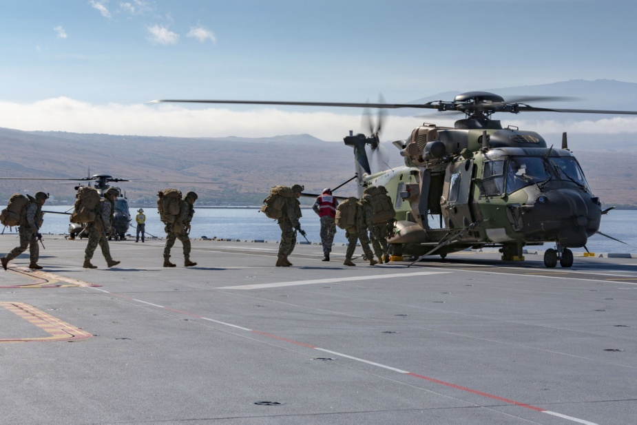 US Marines board HMAS Adelaide's MRH-90 helicopter during amphibious operations off Hawaii as part of Exercise RIMPAC 2018.