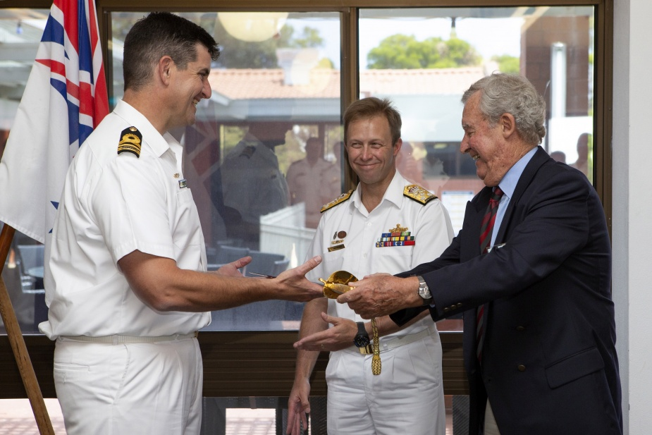 Lieutenant Commander Calvin Timms, RAN, is presented the Vice Admiral Viscount Lord Nelson KB Trafalgar Bicentennial Sword of Excellence by Chief of Navy, Vice Admiral Michael Noonan, AO, RAN, and Nelson Society of Australia Chairman Mike Sargeant, during a lunch at the Sir James Stirling Mess at HMAS Stirling, WA.
