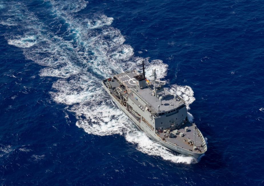 HMAS Melville sails through the Coral Sea.