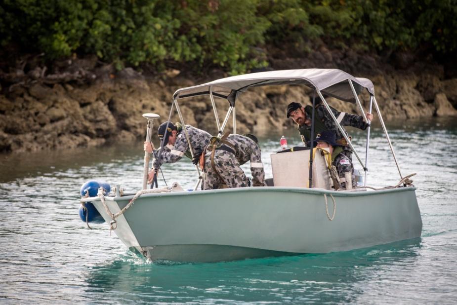 Royal Australian Navy personnel sail HMAS Melville's Light Utility Boat from Tonga Navy establishment HMNB Masefield in Nukuʻalofa, Tonga.