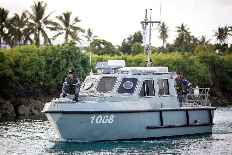 Royal Australian Navy personnel sail one of HMAS Melville's Survey Motor Boats from Tonga Navy establishment HMNB Masefield in Nukuʻalofa, Tonga.