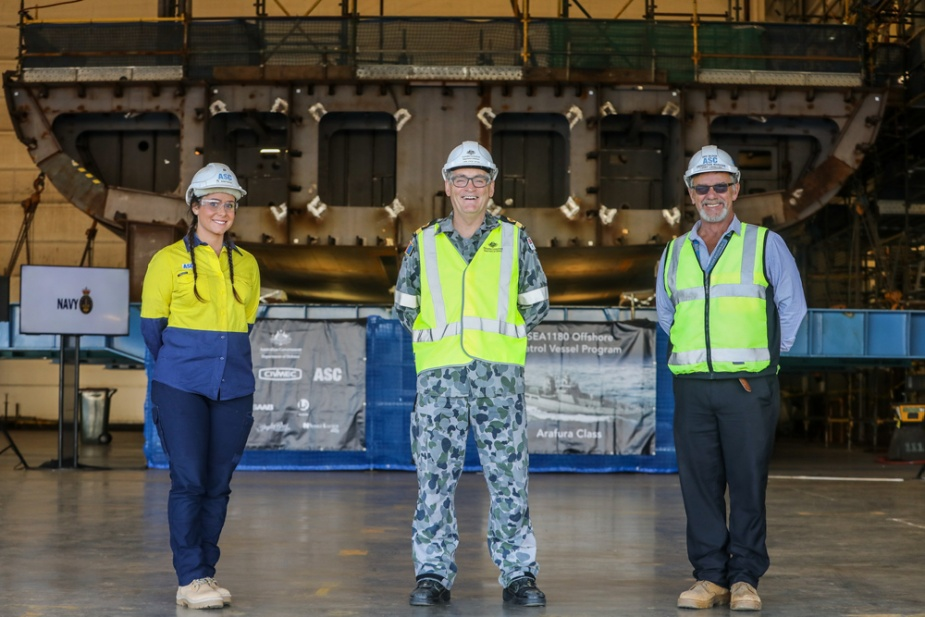 Commodore Steve Tiffen, CSM, RAN, Director General, Naval Construction Branch, with Evyenia Kontakos, Fourth-year Apprentice welder and boilermaker from the Australian Submarine Corporation (ASC) and Larry Lavallee, Offshore Patrol Vessel (OPV) Block Construction Manager, ASC Shipbuilding at the completion of the keel laying ceremony of OPV 2, NUSHIP Eyre.
