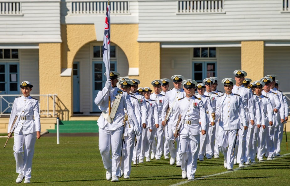 The guard marches onto the parade ground at HMAS Creswell in Jervis Bay during the New Entry Officers' Course 63 graduation ceremony, November 2020.