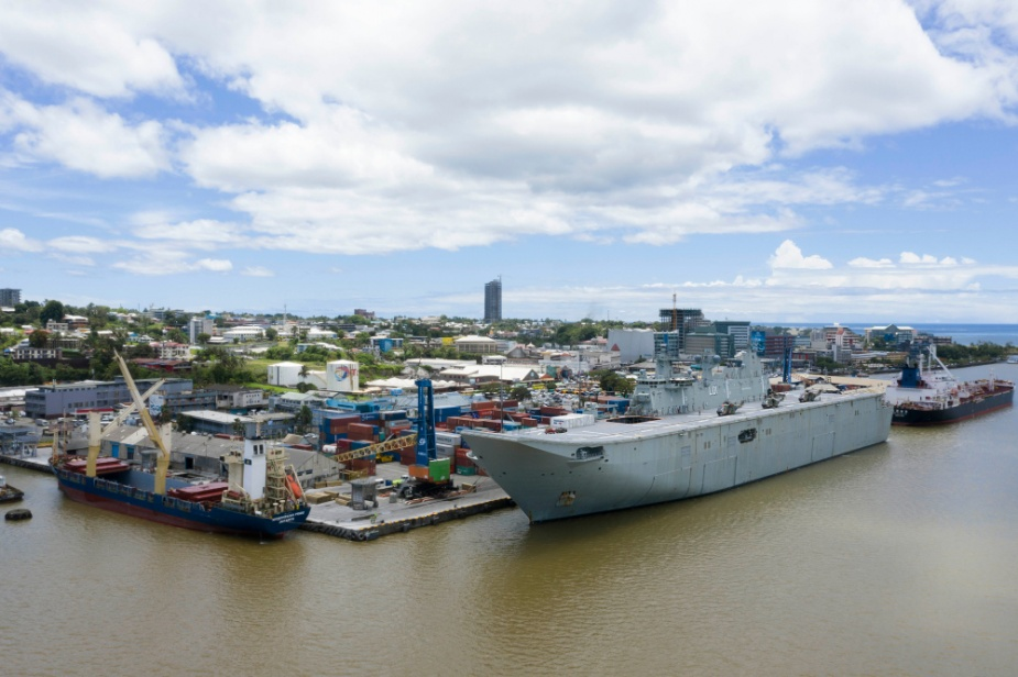 Australian Defence Force personnel load check disaster relief supplies onto HMAS Adelaide at Kings Wharf in Suva, Fiji, during Operation FIJI ASSIST.