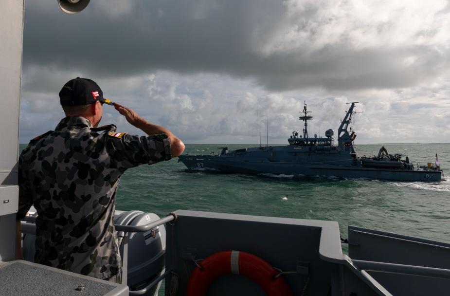 Commander Australian Fleet, Rear Admiral Mark Hammond AM, salutes HMAS Pirie as she passes by while sailing in company with HMAS Maryborough, February 2021.