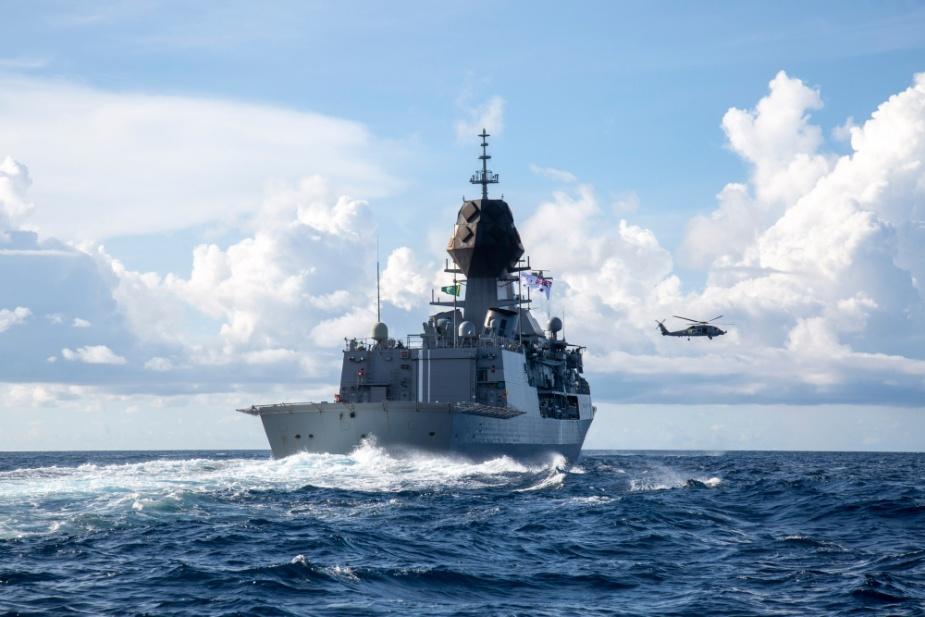 HMAS Ballarat's embarked MH-60R helicopter flies over HMAS Anzac in the South China Sea. Photographer: ABMPO Rikki-Lea Phillips