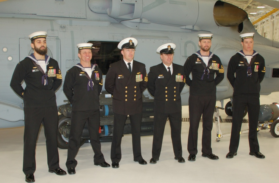 NUSQN 725 members (left to right) LS Eammon O'Brien, LS Tom Clunie, PO Glenn Watson, PO Nathan Minett, LS Chris Hodgkinson and LS Liam Carruthers standing by the RAN's No. 2 Romeo at the 'In Service Date' ceremony in Hangar 1122 24 January 2014. (Photo courtesy Jax Air News)
