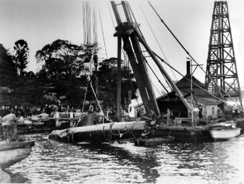 Japanese midget submarine M-21 being salvaged in Taylor's Bay.