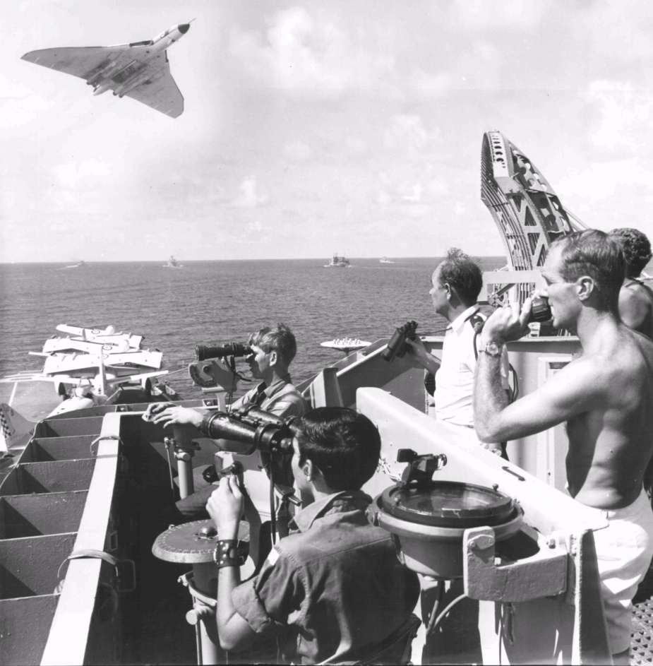 A Britsh Avro Vulcan flies over HMAS Melbourne during exercises in S.E. Asia