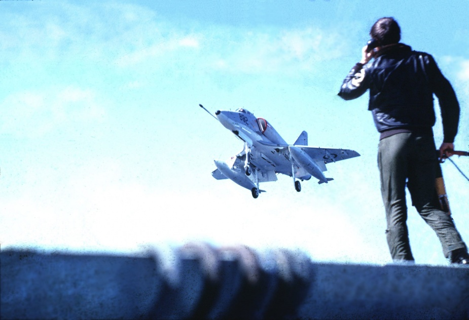 A Skyhawk coming over Melbourne's round-down. In the foreground is the Landing Signal Officer, Lieutenant Peter James. Photo courtesy Lieutenant Commander J Brown.