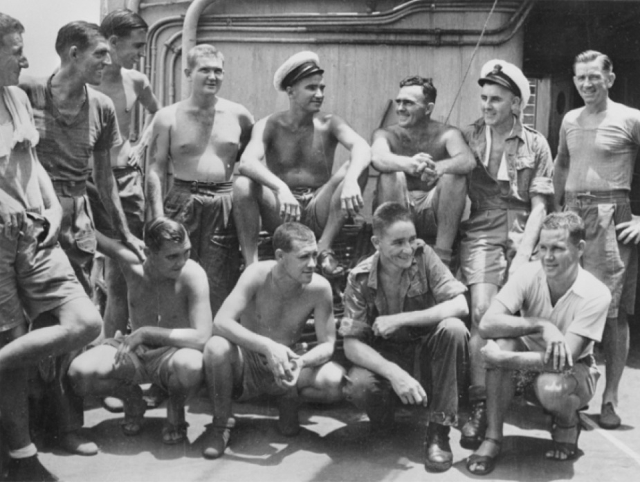 Survivors of HMAS Perth arrive at Darwin on HMT Highland Chieftain. Pictured, left to right: Petty Officer (PO) Robinson of Sydney, NSW; Chief Petty Officer (CPO) Hughes of Sydney, NSW; Able Seaman (AB) Clark of WA; Stoker Axton of Vic; PO Thomson of WA; CPO Barnes of Sydney, NSW; PO Tyrrell of Vic; CPO Bland of Sydney, NSW; AB Woodman of SA; AB Hurst of WA; Stoker Henry of Vic, and Stoker H. W. Mynard of Vic Darwin, NT c.1945.