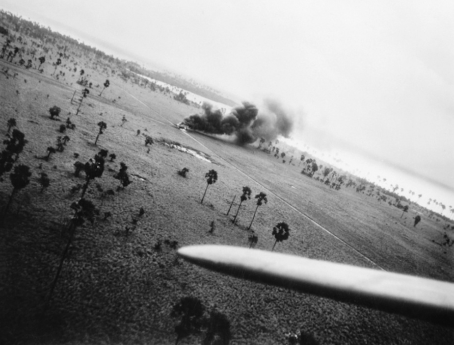 A burning Japanese aircraft following the Beaufighter attack on Selaru (AWM PO1157.007)