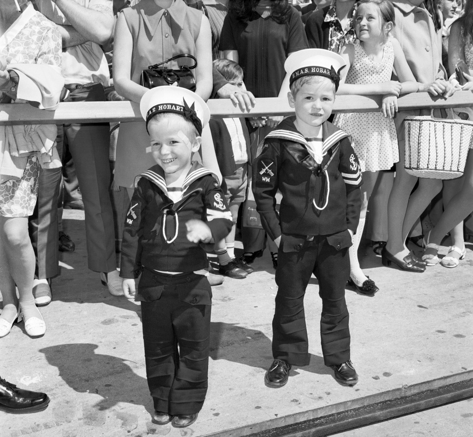 Darryl Aherne, 4, left, and his brother Mark, 5, await the arrival of their father, Leading Seaman Weapons Mechanic Barry Aherne.