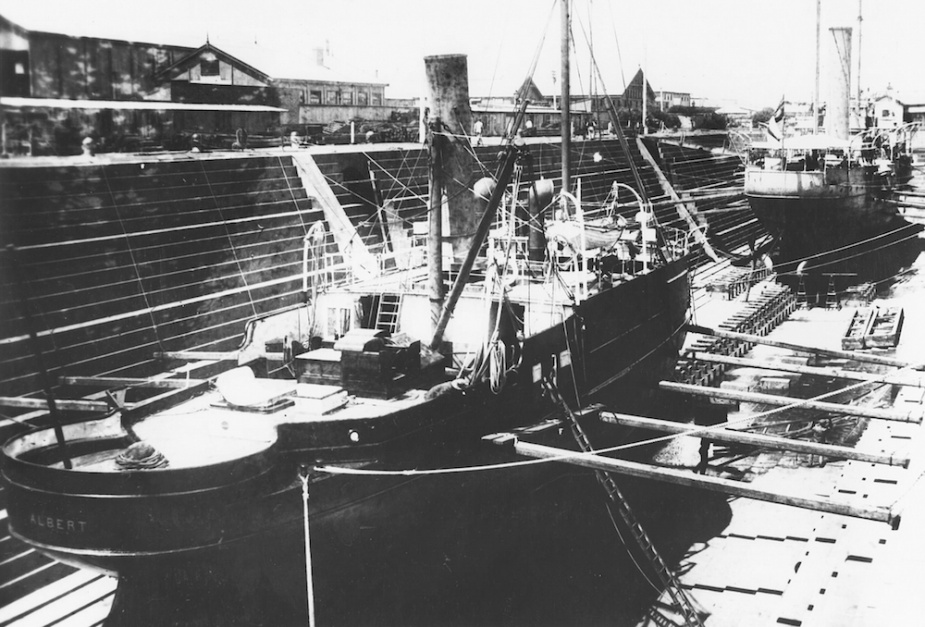 Albert in dock with Victoria visible in the background. Note that Albert has been stripped of her armament andfittings.
